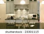Stock photo beautiful kitchen with glass backsplash and granite counter 23301115