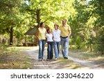 happy cute family walking in... | Shutterstock . vector #233046220
