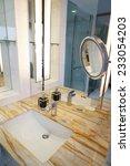 interior of a modern bathroom | Shutterstock . vector #233054203