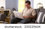 man watching the game on his... | Shutterstock . vector #233235634