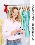 beautiful young stylist near... | Shutterstock . vector #233308900