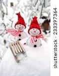 two smiling snowmen friends in... | Shutterstock . vector #233397364