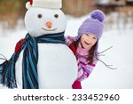 happy kid playing with snowman. ... | Shutterstock . vector #233452960