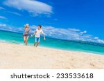 young happy couple running by... | Shutterstock . vector #233533618