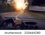 driving a car in the city... | Shutterstock . vector #233664280