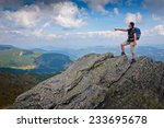 young woman standing on a rock... | Shutterstock . vector #233695678