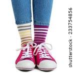 female legs in colorful socks... | Shutterstock . vector #233754856