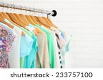 different clothes on hangers... | Shutterstock . vector #233757100