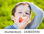 happy kid eating fruits  | Shutterstock . vector #233833540
