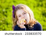 happy kid eating fruits from... | Shutterstock . vector #233833570
