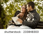 happy couple using tablet... | Shutterstock . vector #233848303