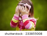 girl is playing hide and seek... | Shutterstock . vector #233855008
