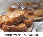 french toasts on a wooden plate.... | Shutterstock . vector #233902738