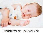 Cute Sleeping Child With Teddy...