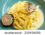 Small photo of Dish of pasta with truffle. selective focus. close-up