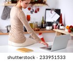 woman using a laptop while... | Shutterstock . vector #233951533