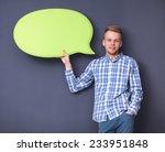 man holding white blank speech... | Shutterstock . vector #233951848