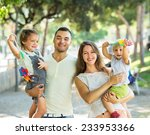 parents walking with children... | Shutterstock . vector #233953366