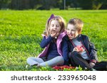 happy kids eating donuts... | Shutterstock . vector #233965048
