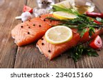fresh salmon with spices and... | Shutterstock . vector #234015160