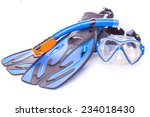 Blue diving goggles,snorkel and flippers on white background. - stock photo
