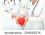 two woman doctor holding a red... | Shutterstock . vector #234033274
