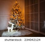 a lighted christmas tree with... | Shutterstock . vector #234042124