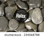 Small photo of The Word 'Relax' On River Stone Surrounded By Other Stones/ Relax Stone
