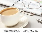 a cup of coffee  glasses and a... | Shutterstock . vector #234075946