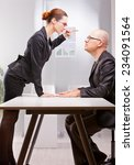 Small photo of woman towering on a business man standing her outburst