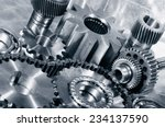Small photo of cogwheels, gears and timing-chain, aerospace parts in titanium and steel