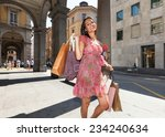 pretty girl with shopping bags... | Shutterstock . vector #234240634