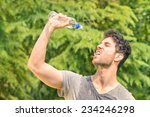 sporty man refreshing with cold ... | Shutterstock . vector #234246298