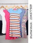female dresses on hangers in... | Shutterstock . vector #234377509