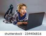 baby girl playing laptop... | Shutterstock . vector #234406816