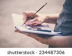 close up hands man writing on... | Shutterstock . vector #234487306