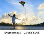 Little Girl Having Fun Flying ...