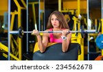 woman in gym lifting weights | Shutterstock . vector #234562678