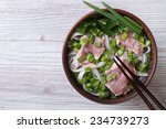 Vietnamese Pho Bo soup with beef and rice noodles close up. top view of a horizontal