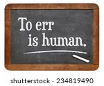 Small photo of to err is human - a quote by English writer Alexander Pope - text on a vintage slate blackboard