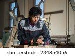 young craftsman in uniform... | Shutterstock . vector #234854056