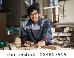 young craftsman in uniform... | Shutterstock . vector #234857959