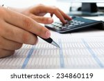 accountant checking numbers on... | Shutterstock . vector #234860119