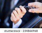 man taking car key | Shutterstock . vector #234866968