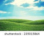 Green Hills Under Bright Sky....