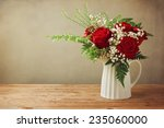 Rose Flower Bouquet On Wooden...