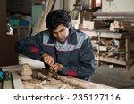 young craftsman in uniform... | Shutterstock . vector #235127116