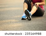 woman runner hold her sports... | Shutterstock . vector #235164988