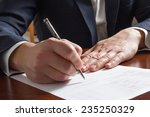 hands signing business documents | Shutterstock . vector #235250329