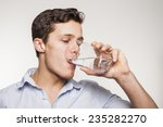 young man drinking water in... | Shutterstock . vector #235282270